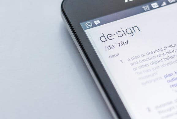 Smart phone displaying definition of the word design